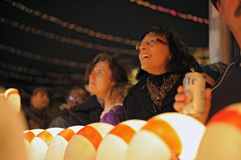 Onlookers take in the sights during the annual 34th Street Christmas lighting ceremony Saturday.