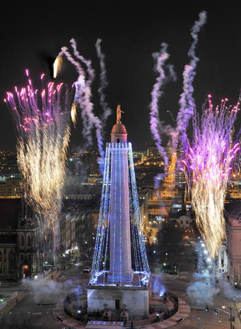 The 39th annual lighting of the Washington Monument in Mount Vernon Square, from the Peabody Court Hotel.