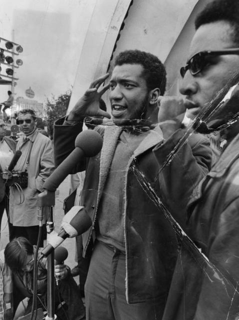 Fred Hampton, of the Illinois Black Panthers, speaks at a rally at Chicago's Grant Park in September 1969. Editors note: There is damage to this historic print.