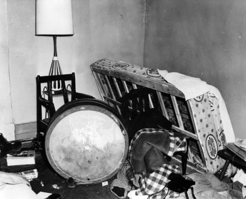 An overturned bed and table in the living room at Black Panther Fred Hampton's West Side apartment, 2337 W. Monroe St., seven days after a deadly Dec. 4, 1969, police raid.
