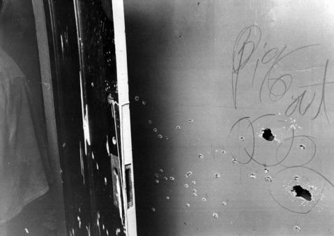 Several bullet holes mar the north wall of the front bedroom in Black Panther Fred Hampton's Chicago apartment Dec. 12, 1969. The living room is on the other side of the wall. Hampton and fellow Panther Mark Clark were slain there Dec. 4.