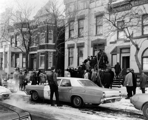 A crowd forms in front of the apartment building where Black Panther Fred Hampton lived as members of a grand jury enter the West Side building Jan. 8, 1970. Hampton and fellow Panther Mark Clark were killed in a police raid there Dec. 4, 1969.