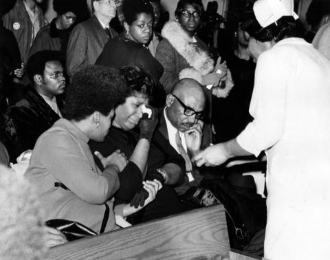 The parents of Fred Hampton, Mr. and Mrs. Francis Hampton, second and third from left, weep during a memorial service for their son Dec. 9, 1969, at First Baptist Church of Melrose Park.