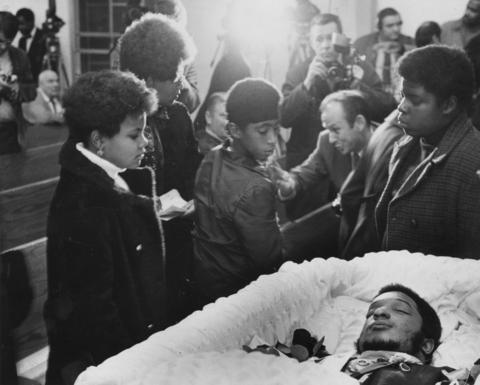 Mourners pass the coffin of Black Panther leader Fred Hampton at his memorial service Dec. 9, 1969, at First Baptist Church of Melrose Park.