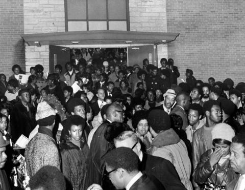 People attend the funeral service for slain Black Panther leader Fred Hampton at First Baptist Church of Melrose Park on Dec. 9, 1969. After the service, Hampton's body was taken to O'Hare International Airport.