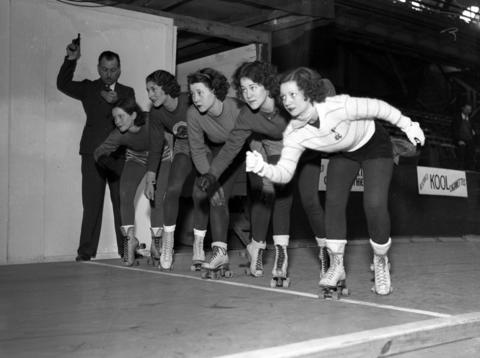 """Roller derby skaters, from left, Louise Thomas, Elizabeth """"Libby"""" Hoover, Pudge Dyer, Jayne Cummings and Mildred Arndt, are started by Harry Newman on Jan. 4, 1936."""