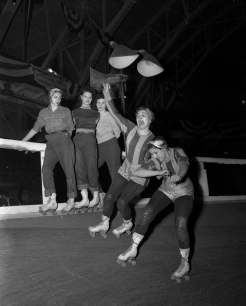 Roller derby veterans Mary Casey and Terry Anderson practiced a move while trainees Betty Backus, of Baltimore, from left, and Barbara Begley and Irene Van Kirk, both of Chicago, watched along the rail during a tryout at the Coliseum in April 1950.