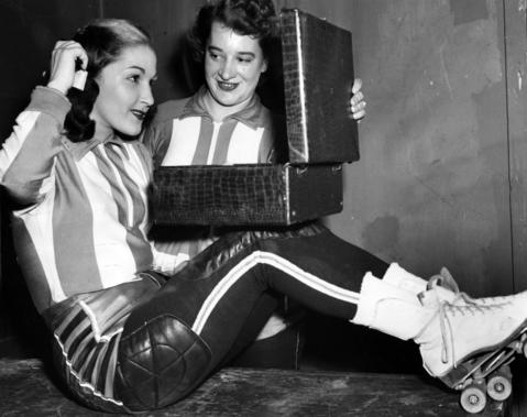 """Mary Lou Palermo, left, and Midge """"Toughie"""" Brasuhn were teammates for the Jersey Jolters and did hair and make-up before a smash-mouth playoff match in Chicago in June 1952. Both Brasuhn and Palermo, who played for many different teams, are in the Roller Derby Hall of Fame."""
