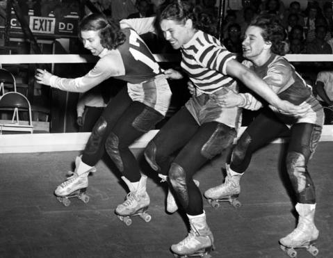 """Chicago's Gerry Murray stays on her feet as Midge """"Toughie"""" Brasuhn, right, tries to take her out on June 10, 1948. Vera Minenko, left, tries to stay upright. Fans tuned in their televisions to watch legendary battles between Murray and Brasuhn, both in roller derby's Hall of Fame. In 1947, Murray became Chicago's team captain, but announced she'd have to retire in two years when her son Mike started school. She never retired. """"That Gerry is the best skater in the business,"""" applauded Billy Bogash, the Chicago men's team captain. Brasuhn was also the mother of a young boy."""