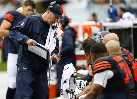 Chicago Bears offensive coordinator and offensive line coach Aaron Kromer speaks to offensive linemen on the bench during a game against the Minnesota Vikings last season at Soldier Field.