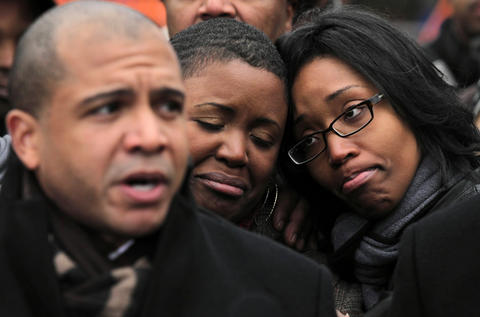 Chicago Ald. Will Burns, 4th, (left) Cleopatra Cowley-Pendleton (center) and Kimiko Pettis (right) attend a press conference in Vivian Gordon Harsh Park in Chicago to announce a reward for information in the shooting death of Cowley-Pendleton's daughter, Hadiya Pendleton, who was shot and killed in the park a day earlier. Pettis is Cowley-Pendleton's sister.