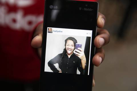 A photo of Hadiya Pendleton is displayed on a cell phone by her 11-year-old cousin Jahlil Pettis outside her South Side home. The 15-year-old King College Prep High School student was shot and killed after school in Vivian Gordon Harsh Park in the 4500 block of South Oakenwald Avenue.