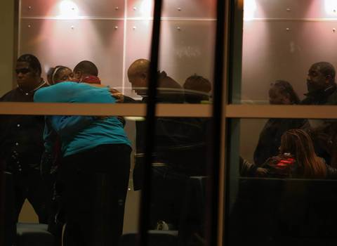 Hadiya Pendleton's mother (second from left) is hugged as the family of the slain 15-year-old gather at Comer Children's Hospital in Chicago.