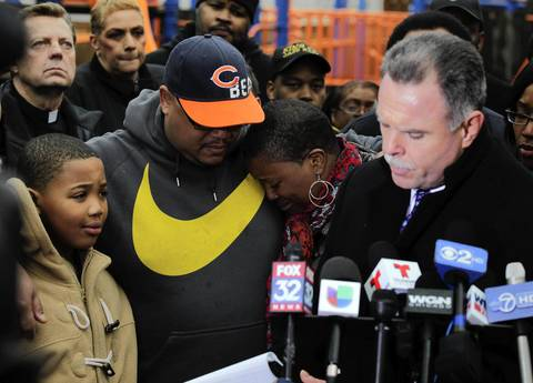 (Left to right) Nathaniel Pendleton, Jr., his father Nathaniel Pendleton, his mother Cleopatra Cowley-Pendleton, and Chicago Police Superintendent Garry McCarthy attend a press conference in Vivian Gordon Harsh Park in Chicago to announce a reward for information in the shooting death of the Pendleton's daughter, Hadiya Pendleton.