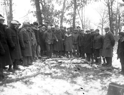 A group stands on a hill known as Battle Ridge, near Rising Sun, Wis., where Clara Olson's body was found Dec. 2, 1926, three months after the young woman went missing. Clara's body was buried in yellow earth, an elopement note from her sweetheart, Erdman Olson, tucked into the bosom. The shallow grave was less than six miles from Erdman's home. Clara's body is outlined by branches on the ground.