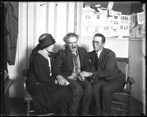 Christ Olson, center, is comforted by his children Alice, left, and Bernard Olson on Dec. 6, 1926, while waiting to be called to the stand at the Prairie du Chien inquest into his daughter Clara's slaying.