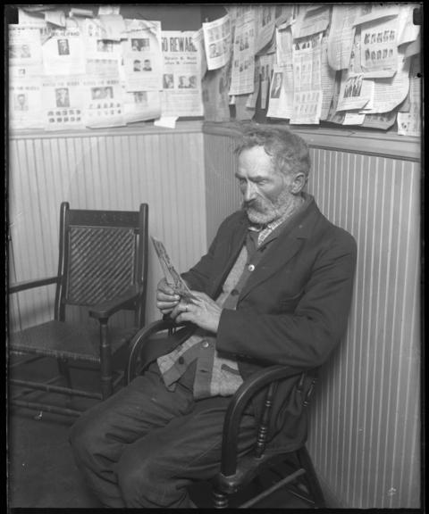 Christ Olson, father of slain 22-year-old Clara Olson, waits during the inquest into her death Dec. 6, 1926.