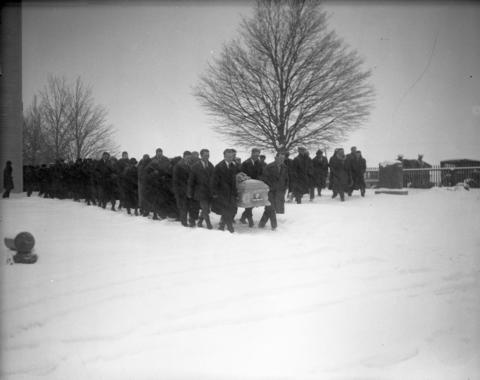 The body of Clara Olson, 22, is laid to rest Dec. 7, 1926, at a graveyard outside Utica Lutheran Church in Mount Sterling, Wis., during a snowstorm.