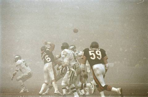"""Chicago Bears defenders Ron Rivera (59) and Steve McMichael (76) on the field against the Philadelphia Eagles at Soldier Field, on December 31, 1988. The game bacame known as """"Fog Bowl."""""""