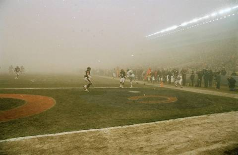 """The Chicago Bears' Vestee Jackson (24) and Todd Krumm (44) defend the incomplete pass to Philadelphia Eagles wide receiver Mike Quick (82) as fog envelopes Soldier Field on December 31, 1988. The Bears beat the Eagles 20-12 in the game known as """"Fog Bowl."""""""