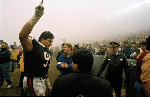 "Defensive tackle Dan Hampton celebrates the Chicago Bears win over the Philadelphia Eagles on December 31, 1988, in the game that became known as ""Fog Bowl."" The Bears beat the Eagles 20-12."