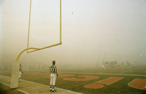 "Officials keep their eyes on the ball as it sails toward the uprights during ""Fog Bowl,"" the game played at Soldier Field on December 31, 1988 between the Chicago Bears and the Philadelphia Eagles."