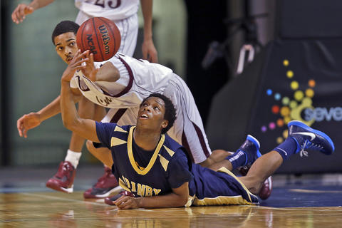Staff Photo Of The Week: Dec 20-Dec 26, 2014     Heritage's Donnie Thomas battles for a loose ball with Granby's Jhamani Johnson during the Scope Holiday Invitational Tournament in Norfolk on Friday.