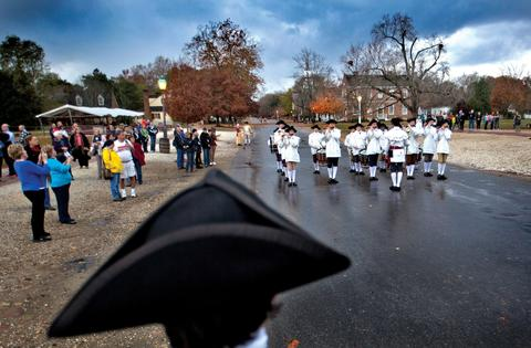 Staff Photo Of The Week: Nov 15-Nov 21, 2014 Colonial Williamsburg rounds up local troops for Gen. George Washington to check over. The afternoon muster of American Troops and the Fife and Drum Corp on Duke of Gloucester Street with dark skies filled with rain.
