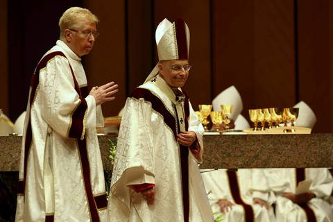 Cardinal Francis George, right, celebrates the 50th anniversary of his ordination as a priest Dec. 18, 2013, at Holy Name Cathedral in Chicago.