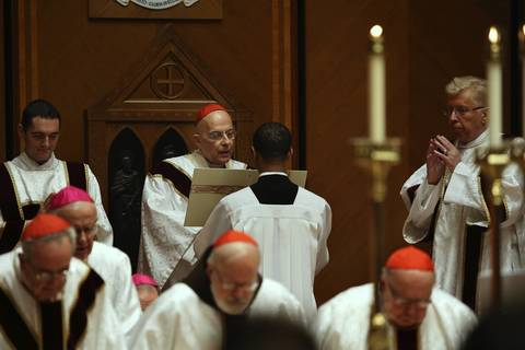 Cardinal Francis George celebrates the 50th anniversary of his ordination as a priest Dec. 18, 2013, at Holy Name Cathedral in Chicago, where he is surrounded by bishops and cardinals from across the United States.