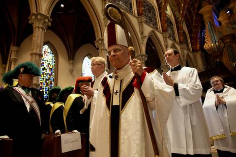 Cardinal Francis George walks in a procession through Holy Name Cathedral in Chicago where he is being celebrated Dec. 18, 2013, for the 50th anniversary of his ordination as a priest. The Mass was attended by bishops and cardinals from across the United States.