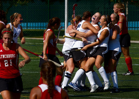 CNU field hockey teammates celebrate after Brianna Milne's score in the second half against Lynchburg Saturday at CNU. CNU went on to win the matchup 1-0.
