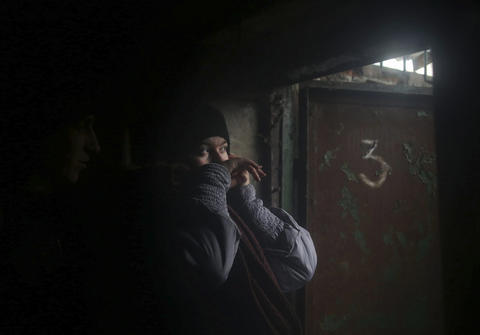 Residents hide in a basement in the eastern Ukrainian region of Donetsk on Tuesday, Jan. 20, 2015.