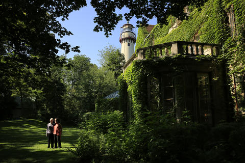 Barbara Janes, left, and Mary Rosinski, both of Evanston, stand in the rear of the Harley Clarke Mansion on July 11, 2013.
