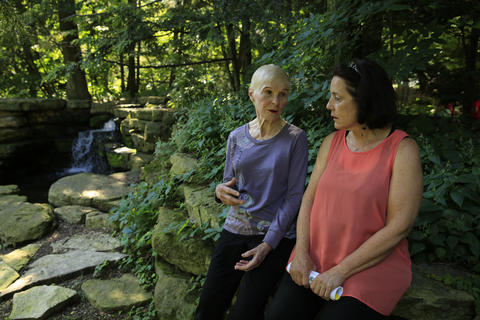 Barbara Janes, left, and Mary Rosinski, both of Evanston, stand near a pond July 11, 2013, behind the Harley Clarke Mansion, part of the Jens Jensen design of the grounds in Evanston. Both women had worked to stop private development of park land surrounding the mansion.