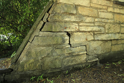 Crumbling masonry is among the items needing repair on the ivy-covered Harley Clarke Mansion in Evanston.