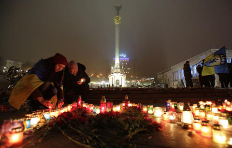 People set candles on Independence Square in Kiev on Jan. 24, 2015 in memory of people who died during shelling in the southern Ukrainian city of Mariupol.
