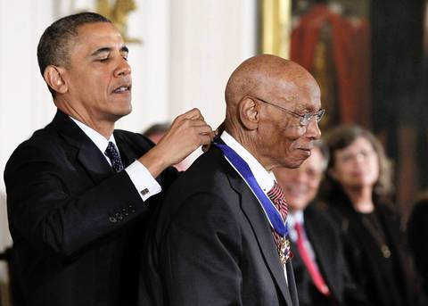 President Barack Obama presents the Presidential Medal of Freedom to Hall of Fame baseball player Ernie Banks on Nov. 20, 2013, at a ceremony in the East Room of the White House.