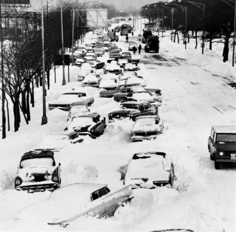 Twenty-three inches of snow, the largest single snowfall in Chicago history, covered the city and suburbs in the blizzard of 1967. Abandoned vehicles made even major streets and highways impassable.
