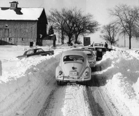 Traffic comes to a stop on Ill. Route 53 at Schaumburg Road on Jan. 29, 1967, as efforts continue to dislodge vehicles from snow drifts.
