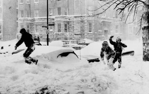At least some enjoyed the snow of the 1967 blizzard. Twenty-three inches of snow, the largest single snowfall in Chicago history, covered the city and suburbs. Children frolic among buried cars in the Edgewater neighborhood on Chicago's North Side.