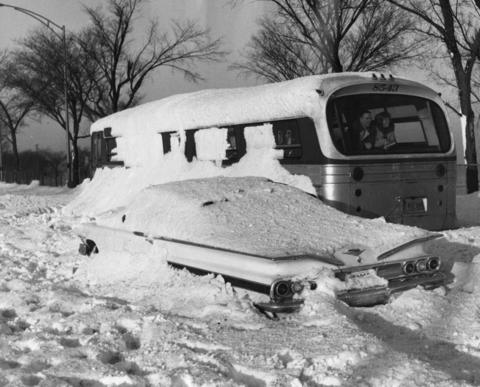 Two passengers stuck in a bus stuck next to a car enjoy the view on North Lake Shore Drive on Jan. 28, 1967.