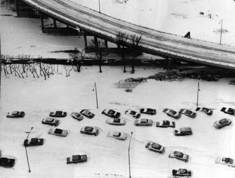 Cars sit marooned in snow drifts on Lake Shore Drive near McCormick Place in Chicago on Jan. 27, 1967.