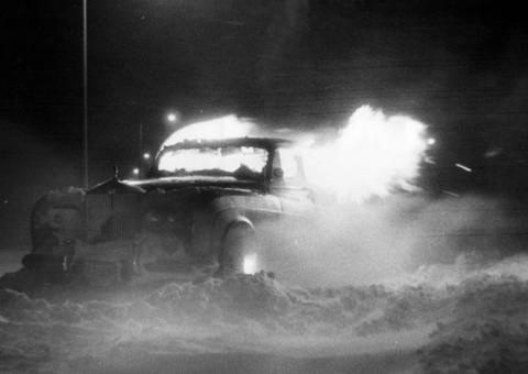 An abandoned Rolls Royce catches fire and burns after getting stalled in drifting snow on the Edens Expressway, a little south of County Line Road on Jan. 26, 1967.