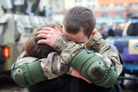 "An Ukrainian policeman embraces his wife during a ceremony in Kharkiv, northeastern Ukrainian, on January 30, 2015, before his departure to the east of the country where they will take part in ""Anti-Terrorist Operation"" (ATO)."