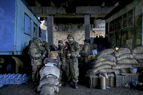 Ukrainian servicemen stay on their position at the checkpoint under the bridge of Peski village near of Donetsk, Ukraine.
