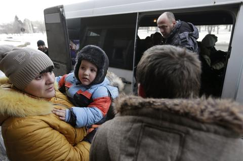 People board a bus to leave the town of Debaltseve, Ukraine.