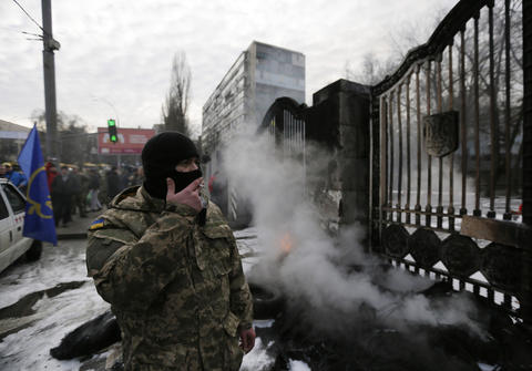 Volunteers of the Aidar battalion burn tires in front of the Ministry of Defense as they protest against a decision to change the leadership of the battalion in Kiev, Ukraine, on Feb. 2.