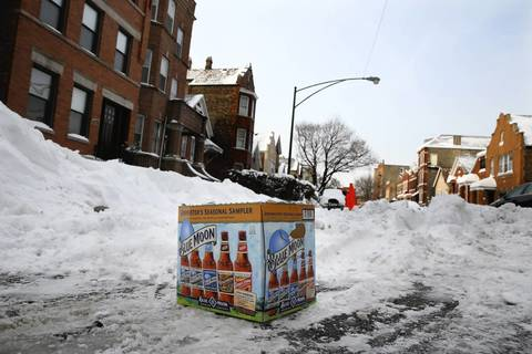 "High-end beer cartons are used to hold ""dibs"" on parking spaces in Bridgeport in Chicago."