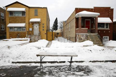A folding table marks a parking spot on Drummond Place east of Central Avenue, in Chicago.